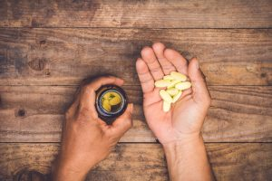 supplements in man's palm
