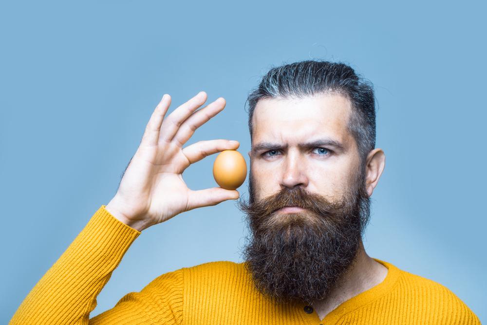 masculine guy holding egg