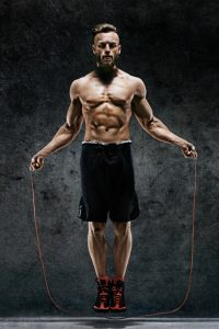 fit guy skipping rope