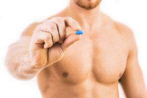 man holding ED pill