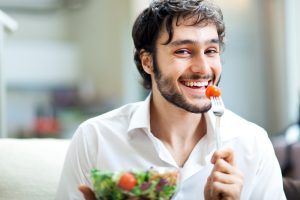 man enjoying a salad