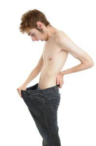 emaciated guy looking down his junk