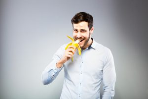 man enjoying a banana
