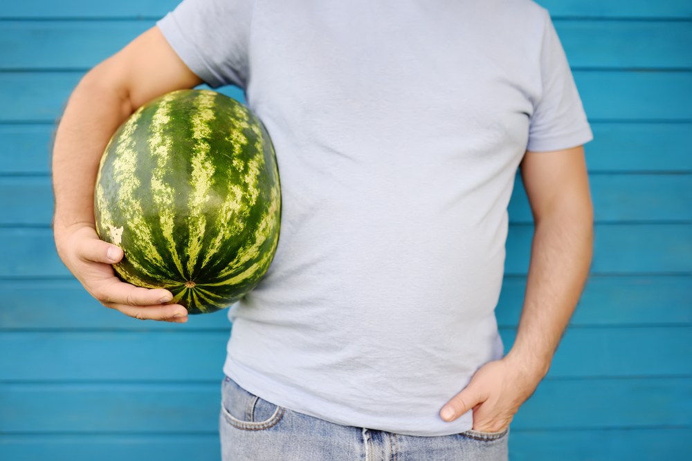 man holding watermelon