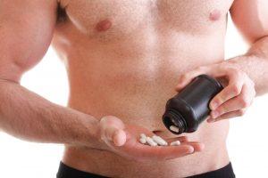 man taking testosterone pills