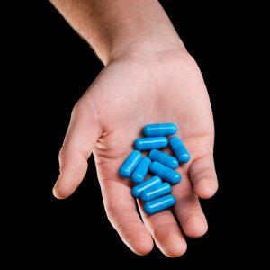 handful of supplement pills