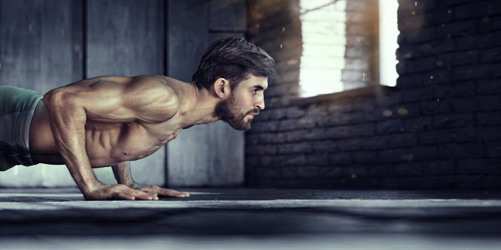 fit guy doing push ups