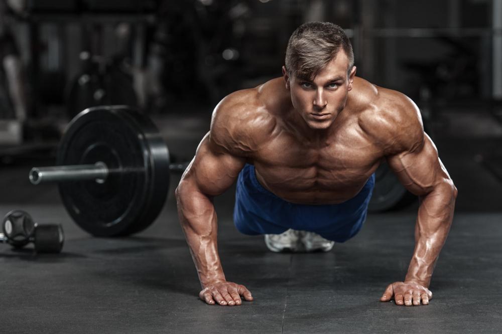 shirtless muscular guy push up