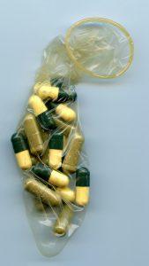 supplement capsules inside condom