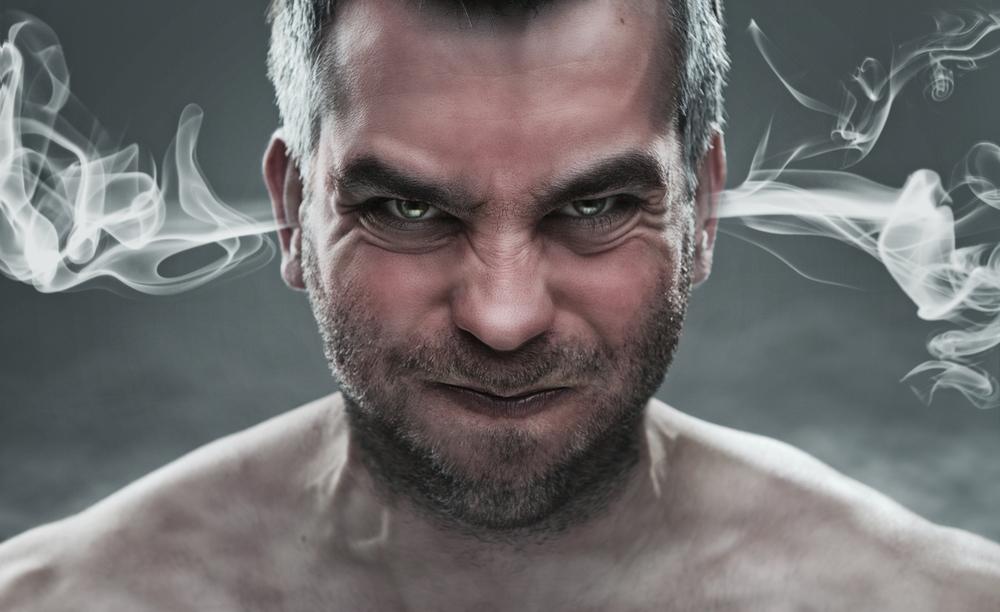 aggressive man smoking ears