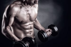 fit man lifting free weights
