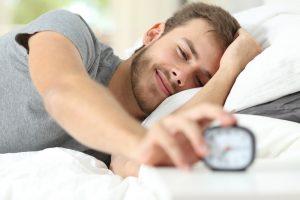 turning off alarm clock in the morning