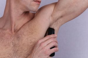 man removing excess body hair
