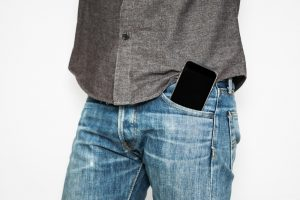 mobile phone on front jean pocket