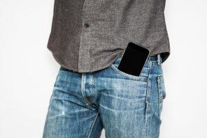 mobile phone on front jean pocket
