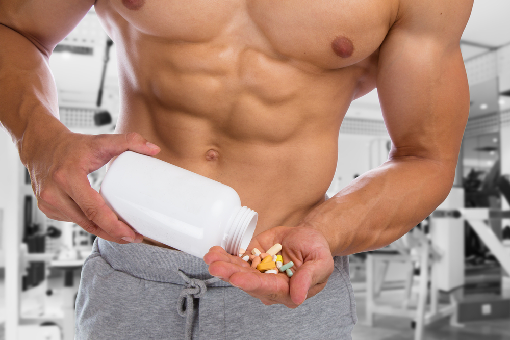 man taking vitamin supplements