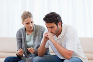 woman explaining to husband