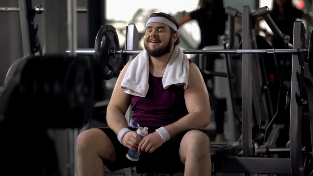 fat man exercising in gym