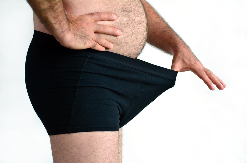 fat man looking inside underwear