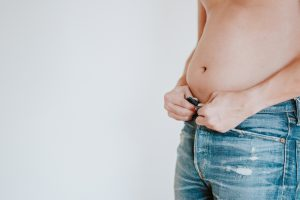 man gaining excess fat in the belly
