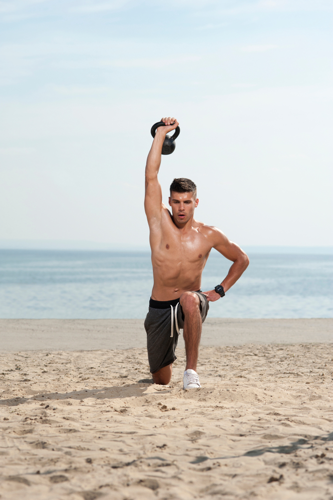 lunge exercise by the beach