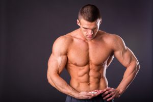 fit man looking at male enhancement pills