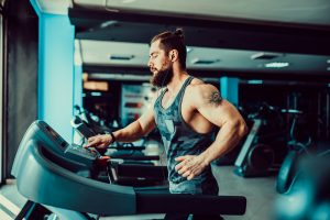 fit man running on treadmill for cardio