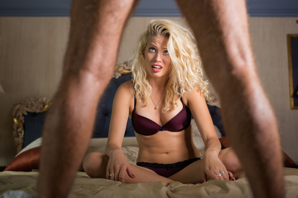woman disappointed with what she sees between his legs