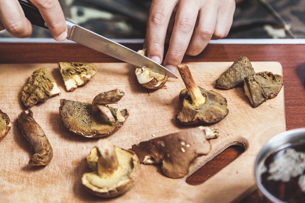 cutting up mushrooms