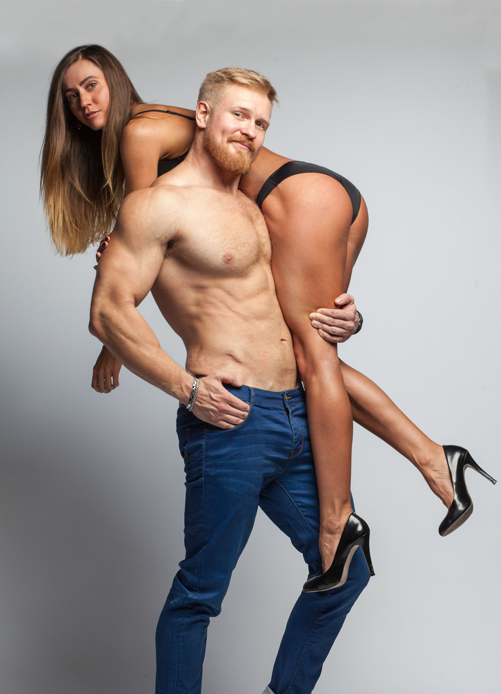 jacked man carrying woman