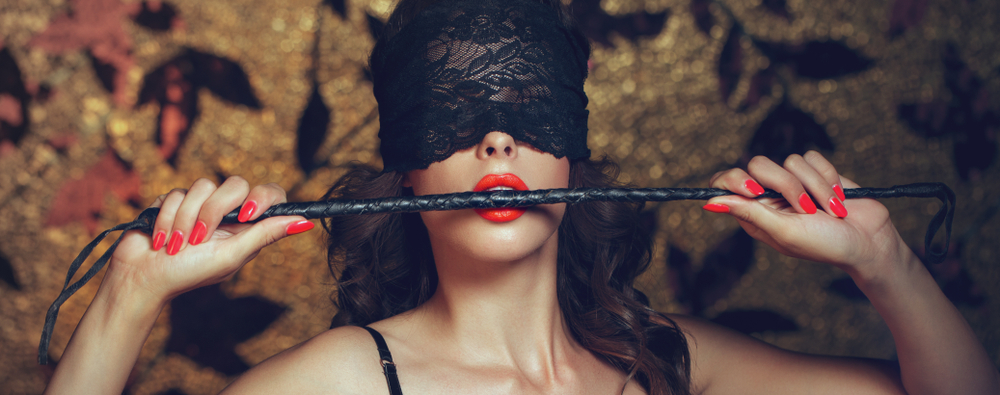 lace blindfold and whip