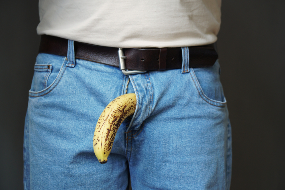 banana out of man's jean crotch
