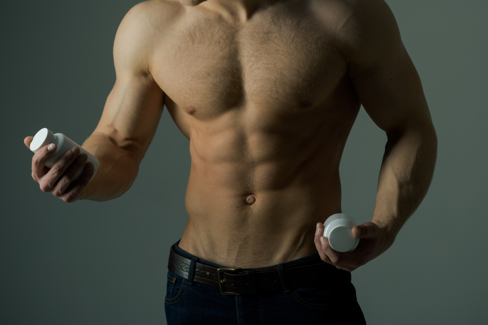 fit man comparing supplements