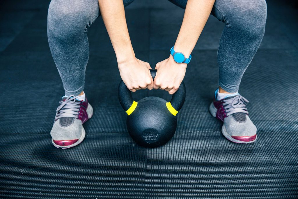 fit female kettle bell exercise