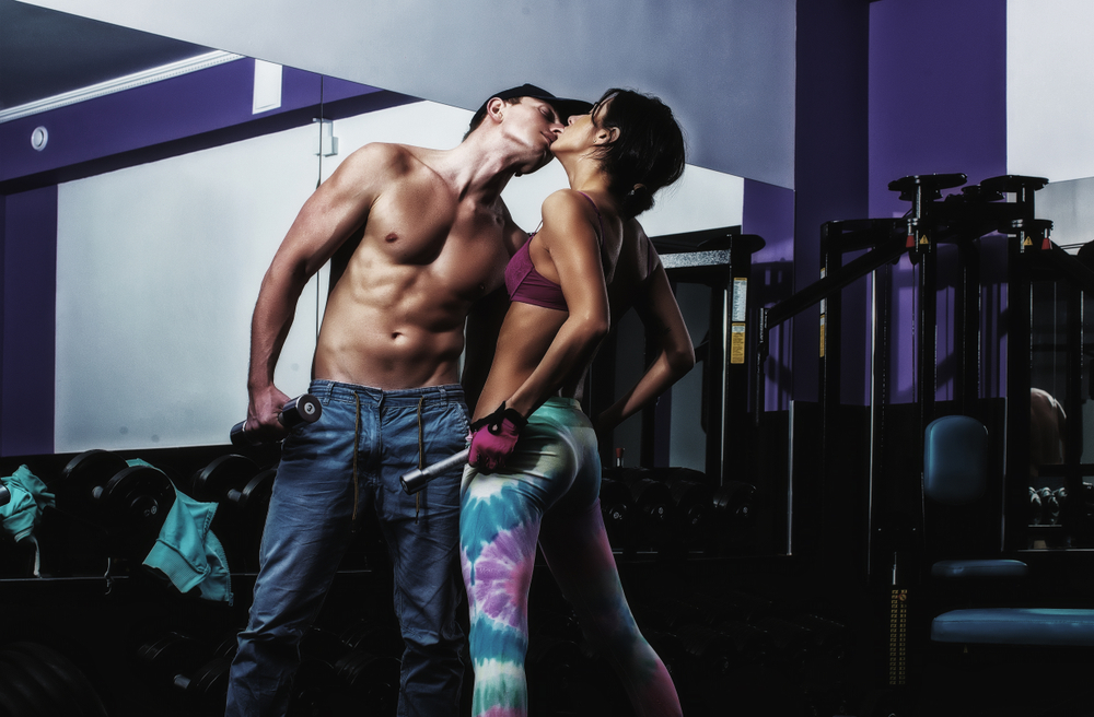 sensual kisses during gym workout