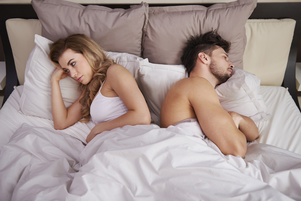 couple in bed having problems and misunderstanding