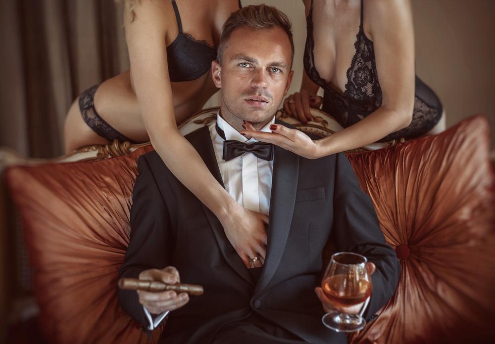 gentleman with two women in lingerie