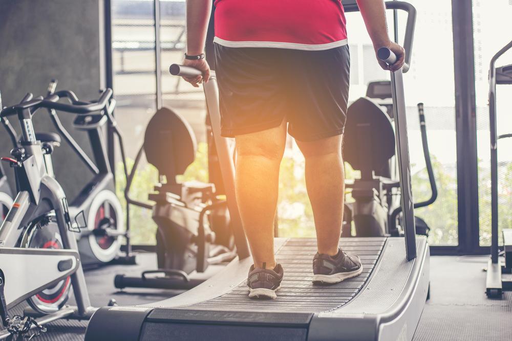 overweight man on treadmill