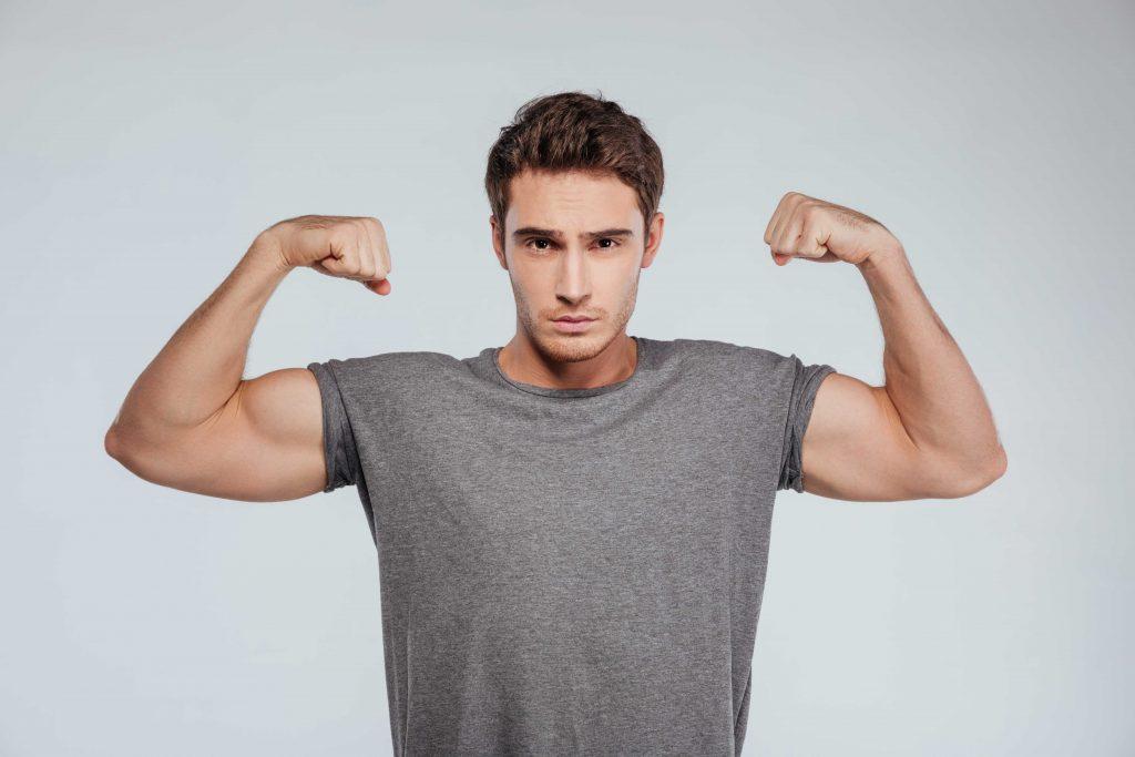 flexing his biceps