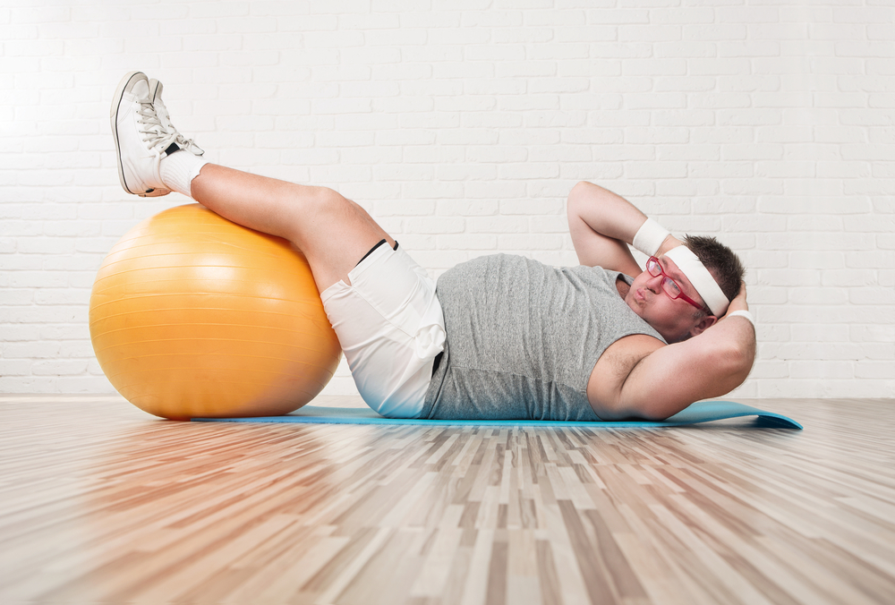 overweight man exercising with crunches