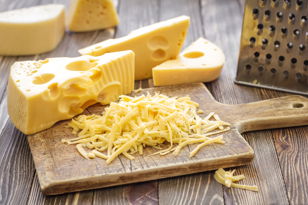 grated cheese on chopping board