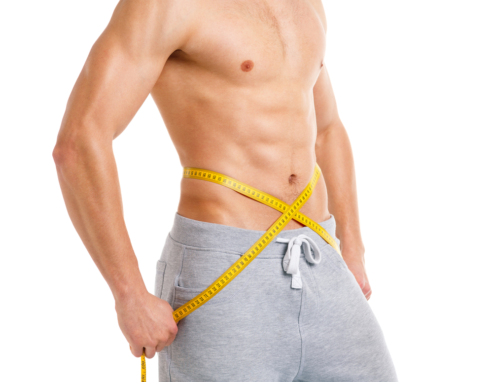 man with six-pack measure waist