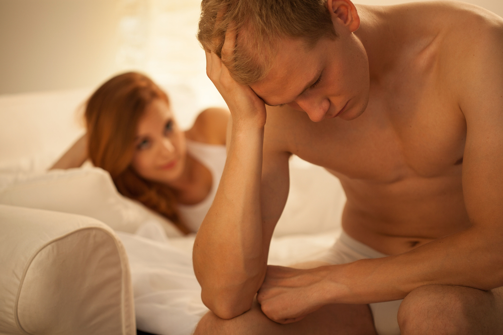 sad man on the bed with wife