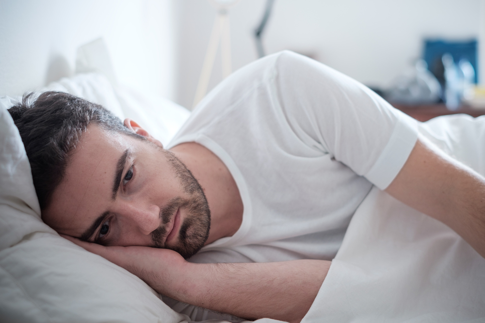 depressed man in bed