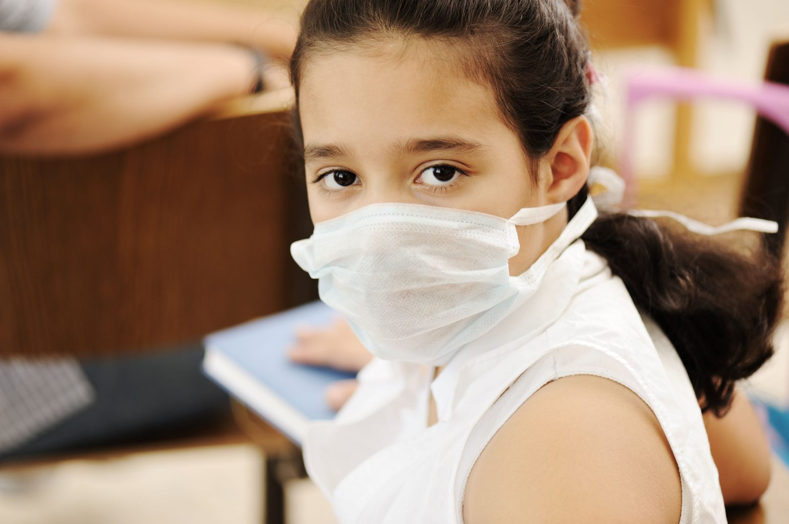 young girl wearing surgical mask