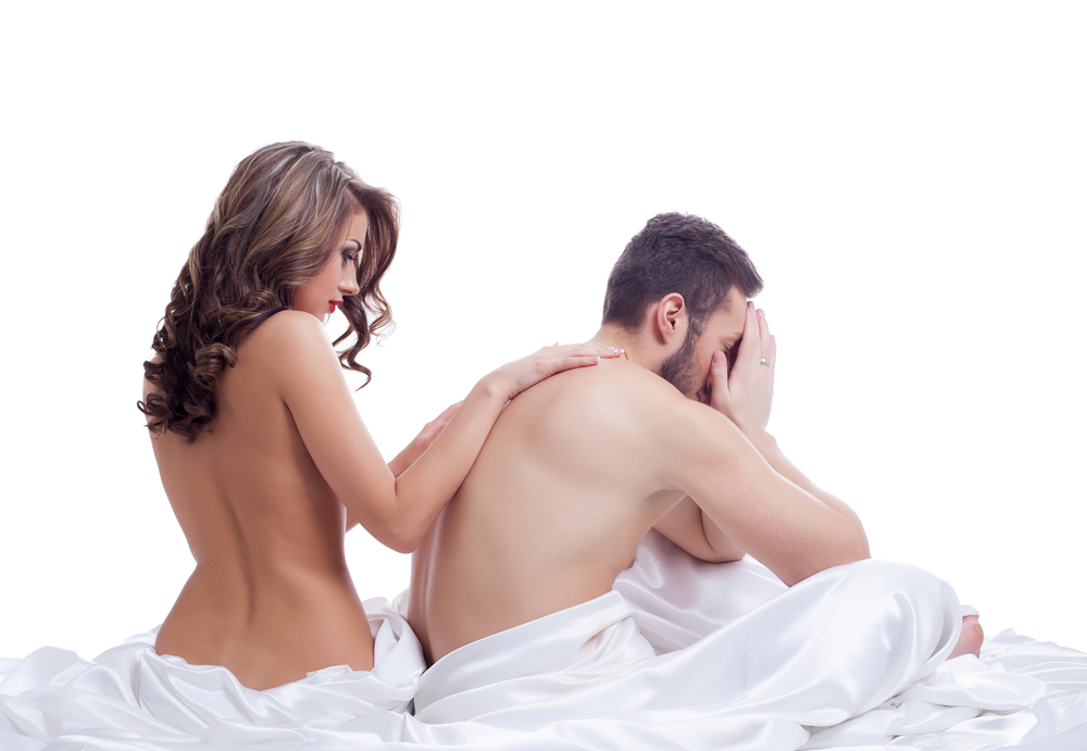 woman comforts husband with sexual problem