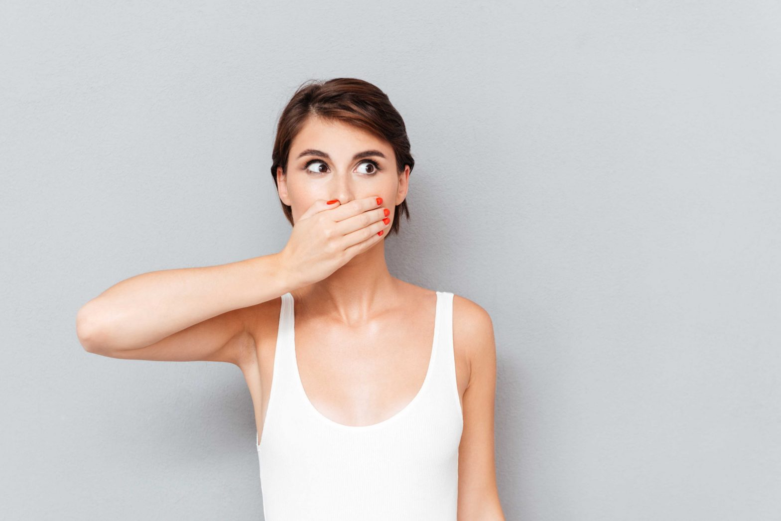 woman covering mouth with one hand