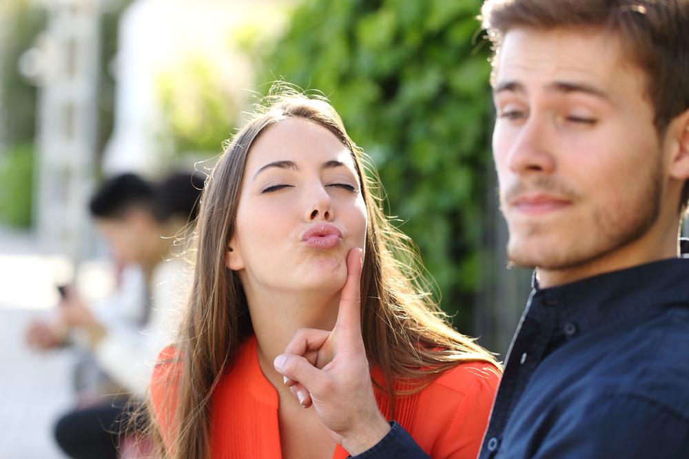 man avoiding kiss
