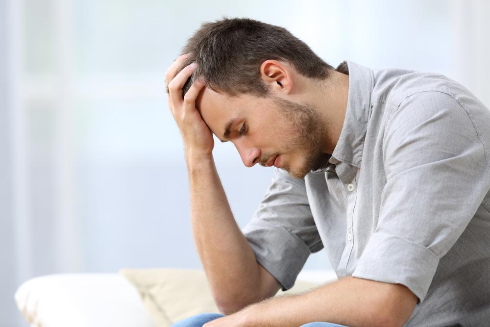 sad contemplating man