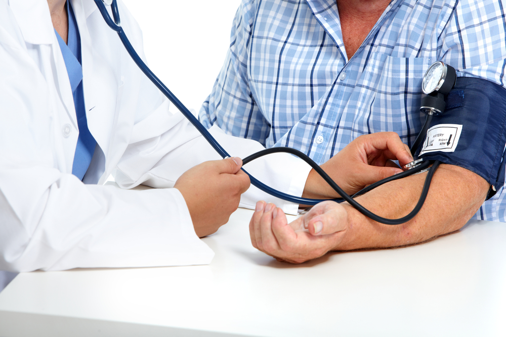 doctor taking vital signs